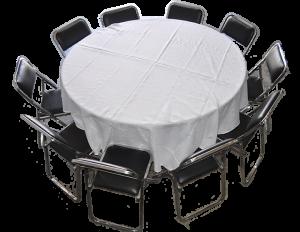 mesa redonda con mantel y sillas acojinadas